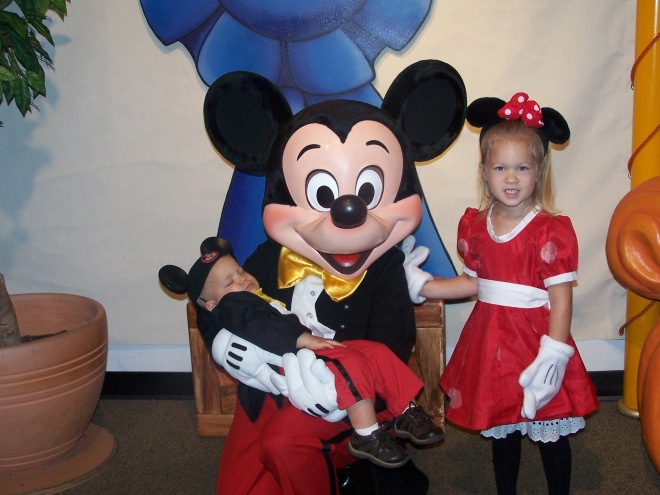 We were so disappointed when 10 mo old Jaron fell asleep waiting in line to see Mickey. We thought Brooklyn would just have to get her pic with Mickey by herself. UNTIL Mickey kneeled down to hold the baby dressed up like him! what a memory ~ october 2004